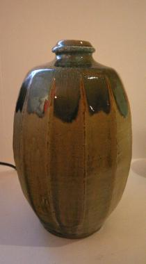 Bottle Faceted. Peat clay ash glaze with Nuka top