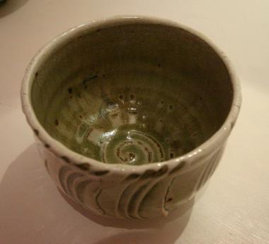 Teabowl. Lattice pattern. Ash glaze, iron dipped rim.
