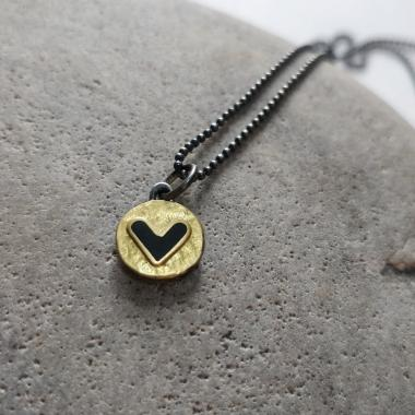 Black heart and gold necklace
