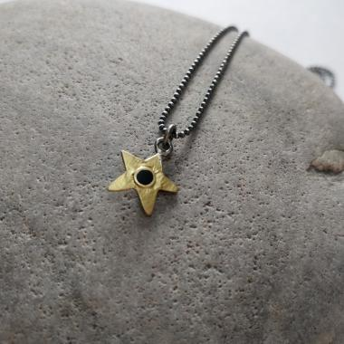 Black star and gold necklace