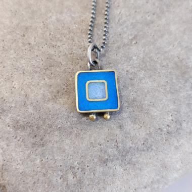 Necklace - bright blue and lilac blue square with two gold balls.