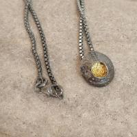 Tiny Closed Limpet Pendant  by Ann Bruford