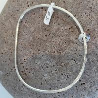 Pebble Bangle with float charms by Ann Bruford