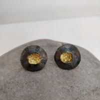 Dark limpet stud earrings  by Ann Bruford