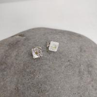 Tiny square studs  by Ann Bruford