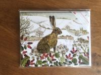 Seated Hare in the Snow - Multipack of 15 Christmas cards by Canns Down Press