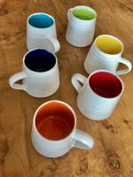 Rainbow Medium Mug by Justine  Jenner