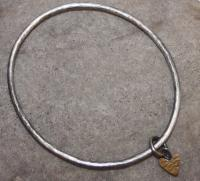 Gold heart with sliver bangle by Zsuzsi Morrison