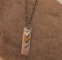 Three heart tag necklace  by Zsuzsi Morrison