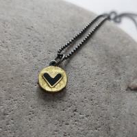 Black heart and gold necklace  by Zsuzsi Morrison