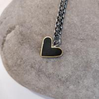 Black heart necklace with an adjustable chain   by Zsuzsi Morrison