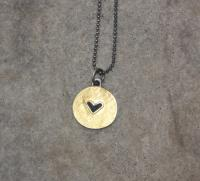 Gold and black heart necklace  by Zsuzsi Morrison