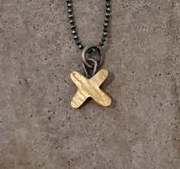 gold cross necklace  by Zsuzsi Morrison