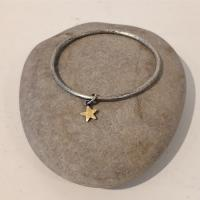 Gold star and silver Bangle by Zsuzsi Morrison