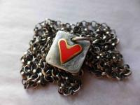 Tiny Red Tag Necklace by Zsuzsi Morrison