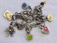 Seven Charm Bracelet by Zsuzsi Morrison